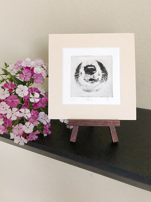 Small Border Collie Dog Art on a table easel with flowers next to it