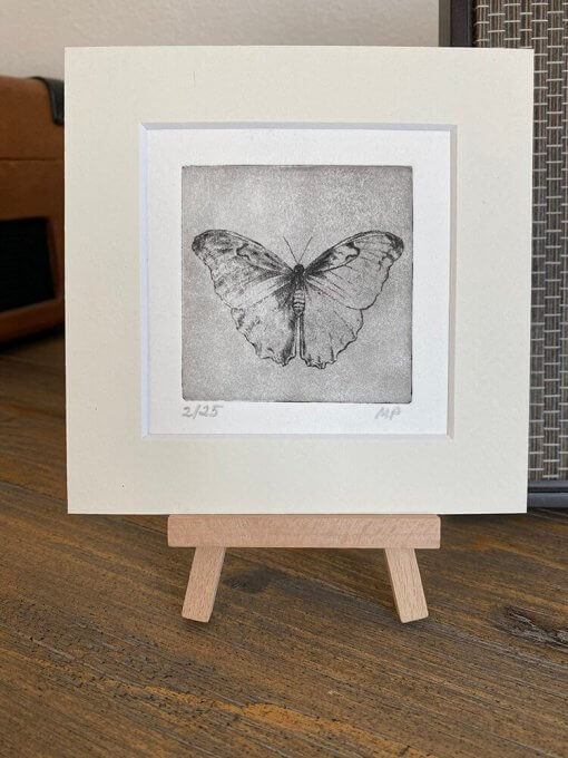 butterfly small art etching on table easel