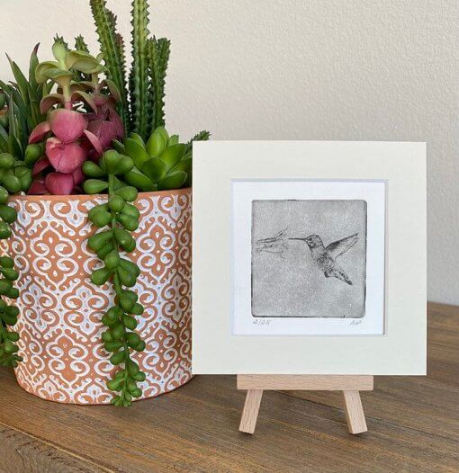 Hummingbird-Art-For-Home on table easel by plant