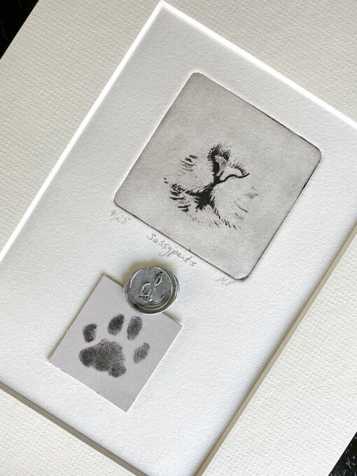 shows one of a kind pet portrait with cat nose and paw print